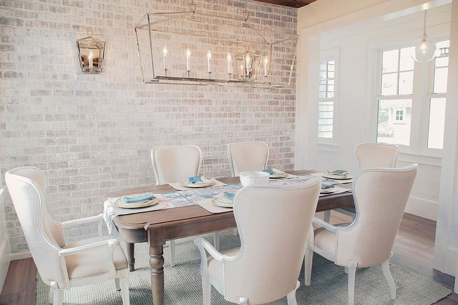 Curated modern dining room with white walls coupled with brick walls