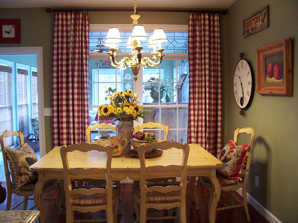 rustic dining room with olive green accent wall