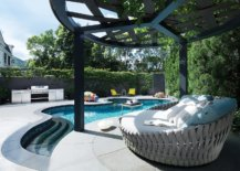 Curvy-pool-area-with-a-fabulous-pergola-next-to-it-and-comfy-lounger-91797-217x155