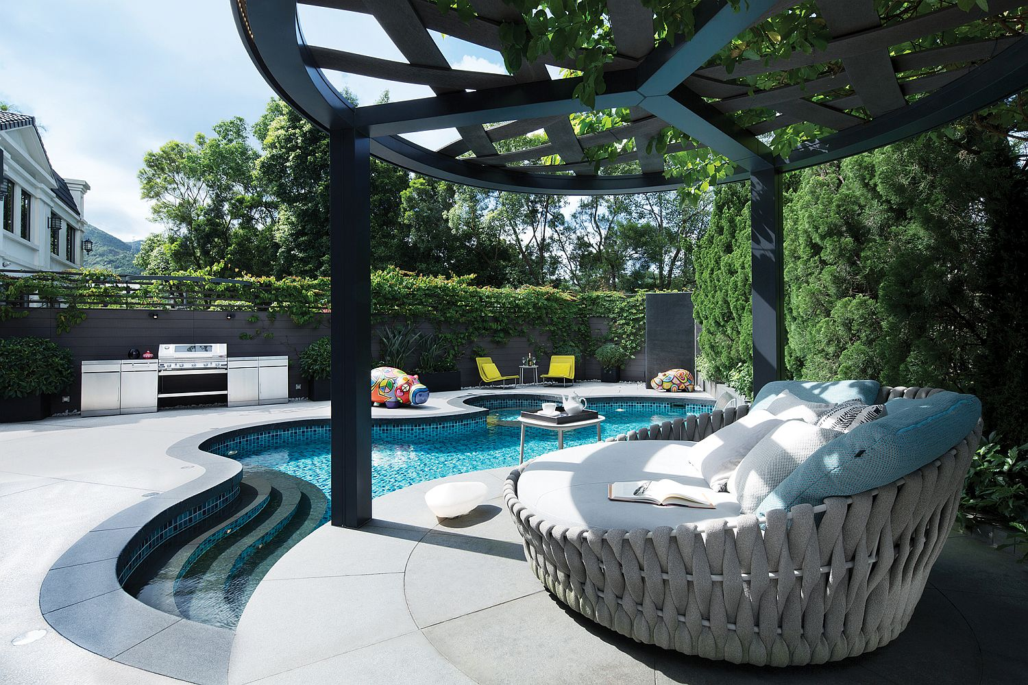 Curvy-pool-area-with-a-fabulous-pergola-next-to-it-and-comfy-lounger-91797