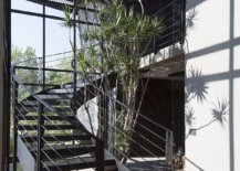 Curvy-staircase-along-with-the-water-feature-creates-a-stunning-entry-space-26071-217x155