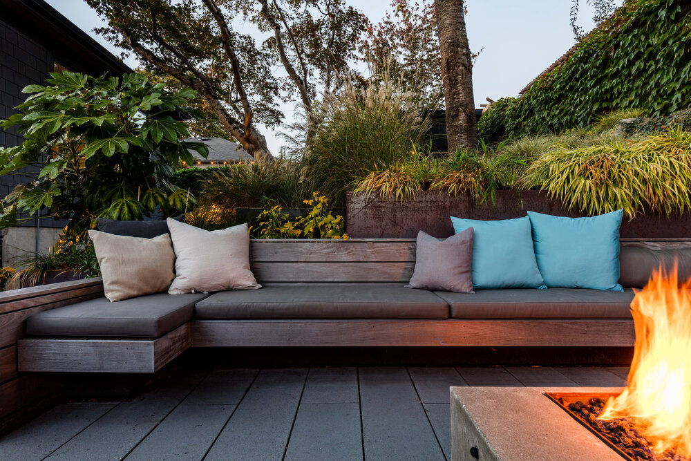 Custom ipe wood benches and cushions create a lovely outdoor sitting area