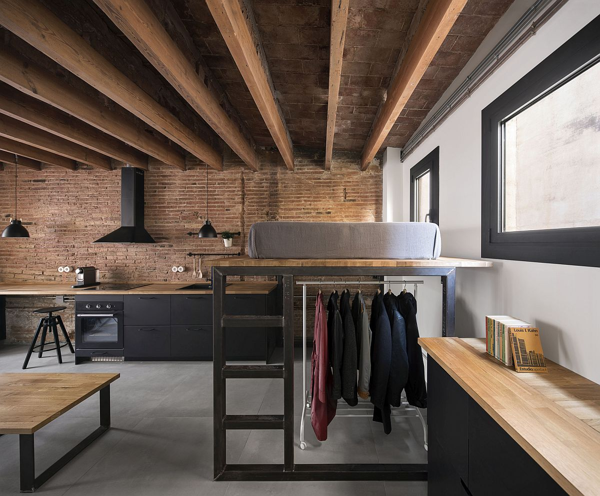Custom shelves, floating bed and other cabinets create a space-savvy apartment interior