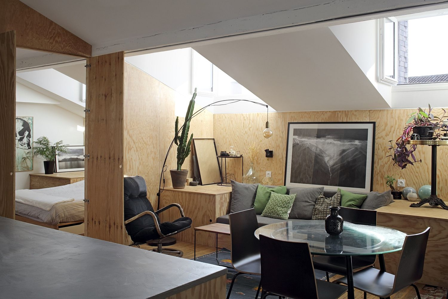Custom wooden platform inside the apartment transforms into different decor pieces with ease