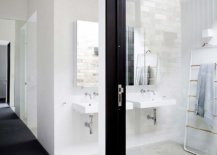 Dark-framed-doors-and-windows-create-visual-contrast-while-anchoring-the-spaces-52403-217x155