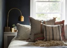 Dark-gray-backdrop-in-the-small-bedroom-gives-it-a-polsihed-urbane-style-75879-217x155