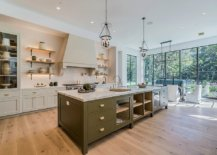 crisp white kitchen with olive green kitchen island