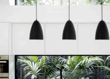 Dark-pendant-lights-usher-in-visual-contrast-to-a-setting-that-is-draped-entirely-in-white-61252-217x155