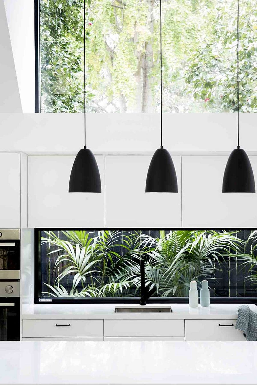 Dark-pendant-lights-usher-in-visual-contrast-to-a-setting-that-is-draped-entirely-in-white-61252