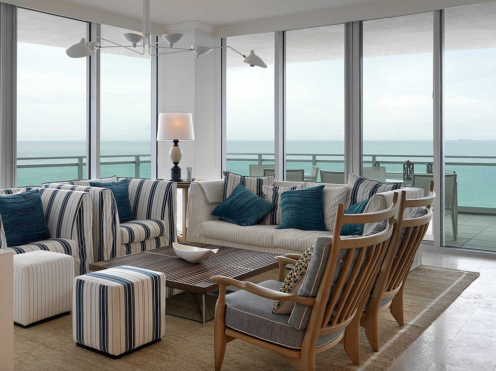Dashing-striped-ottomans-coupled-with-chairs-in-the-polished-contemporary-living-area-with-sea-views-53791