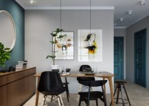 Dining-room-with-aneutral-color-palette-blue-accent-wall-and-wooden-storage-unit-88391-217x155