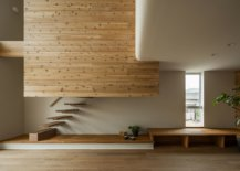 Double-height-living-area-of-the-Japanese-home-with-floating-staircase-wooden-walls-and-ample-natural-light-54564-217x155