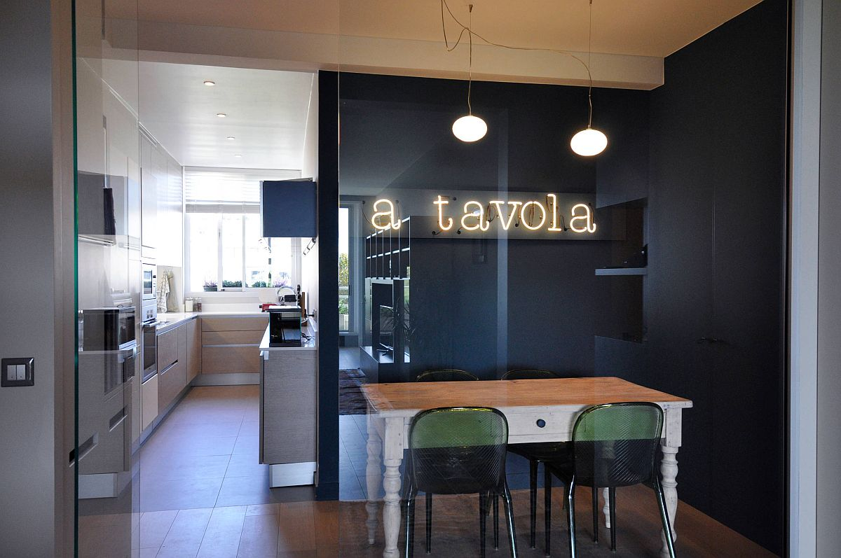 Eat-in kitchen of Paris apartment with a gorgeous neon sign