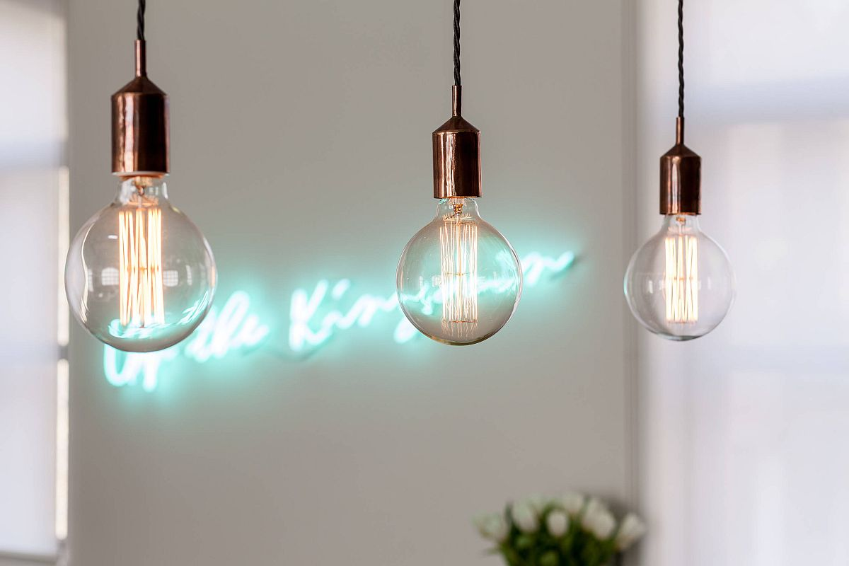 Edison bulb lighting combined with sparkling neon sign in the contemporary kitchen