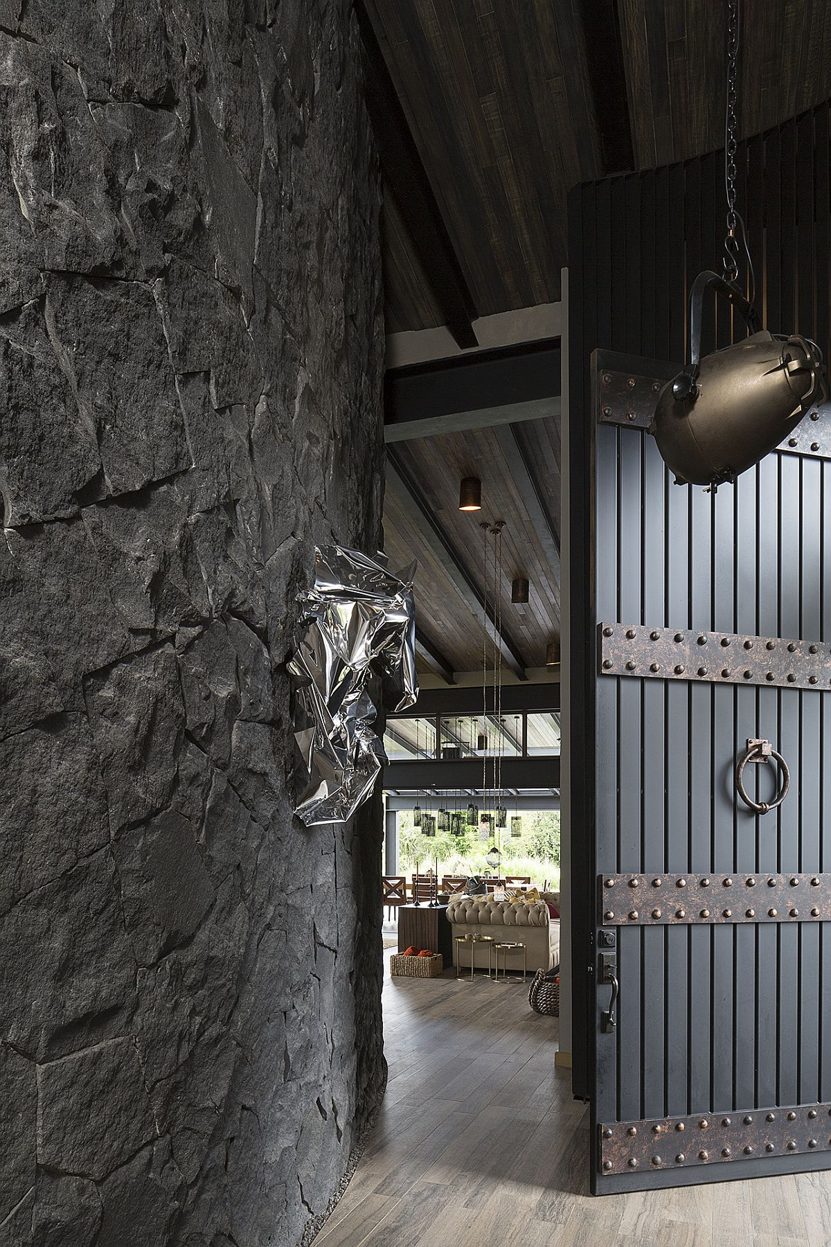 Entrance of the house with traditional Mexican design touches and dark stone walls
