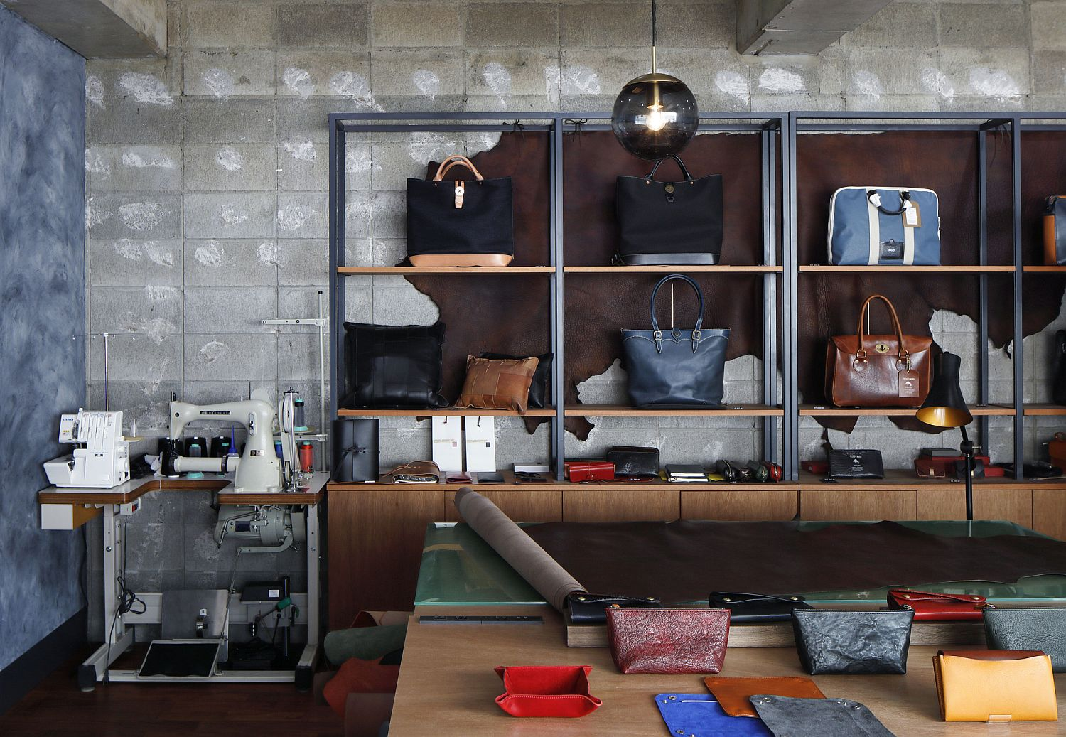 Exposed concrete walls give the interior of the shop a modern industrial appeal