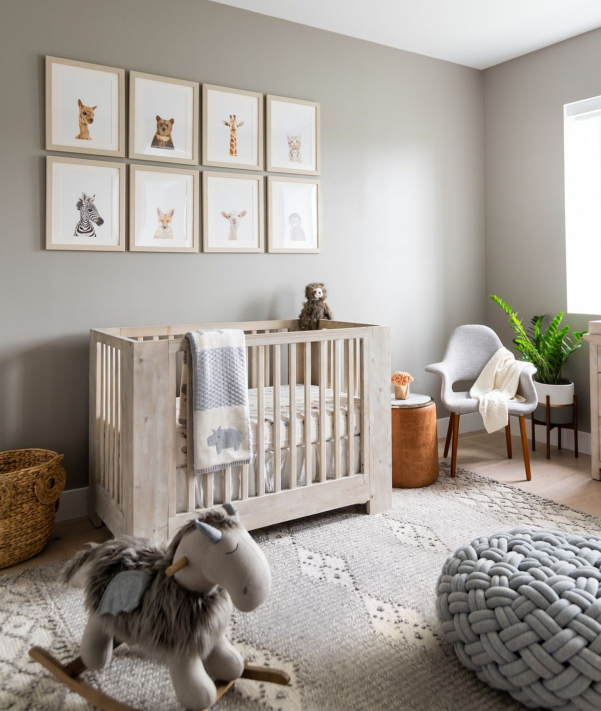 Exquisite modern coastal nursery in gray with refined decor