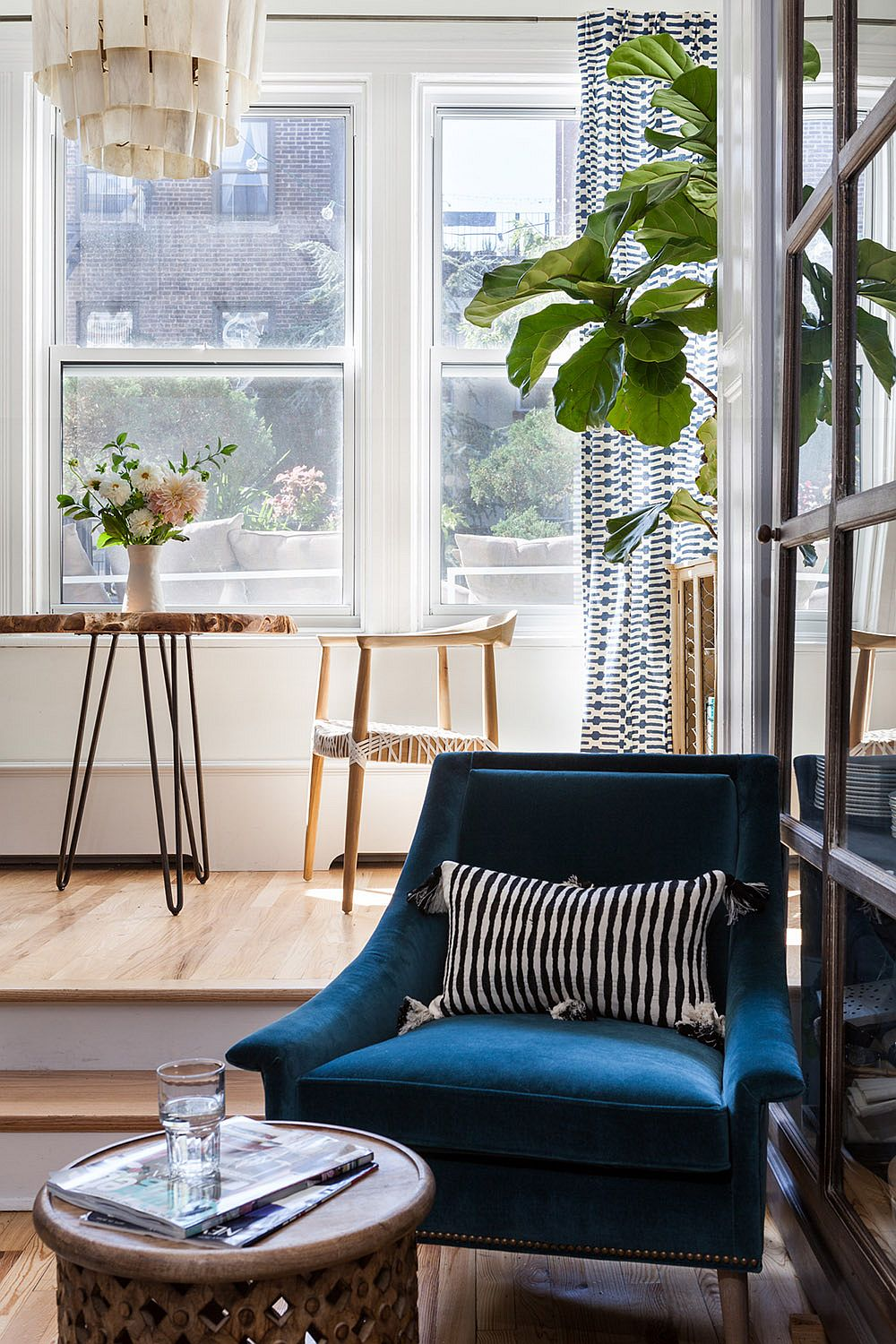 Fabulous blue club chair in the living room makes a big visual impact in the neutral living room