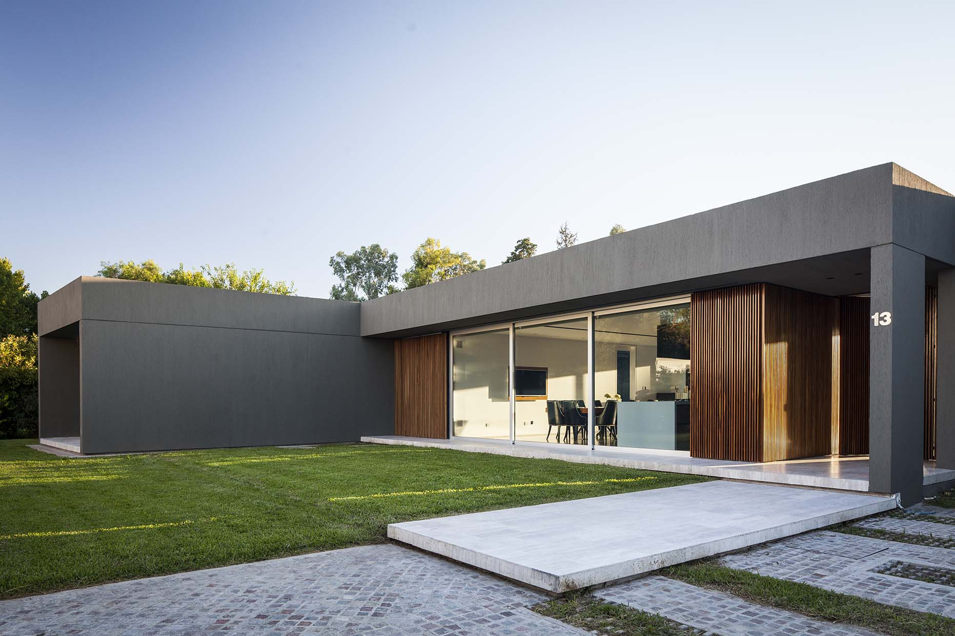 Facade of the House PR in Buenos Aires clad in wood, glass and concrete