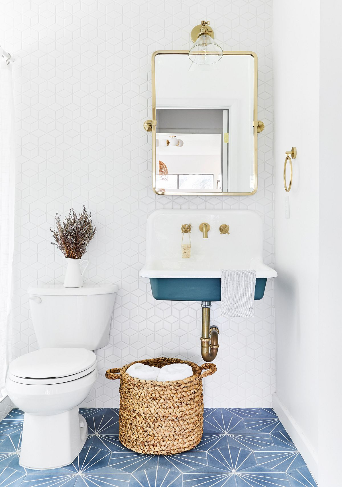 Floor tile adds more than just color to this small modern bathroom in white and blue