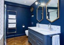 Frames-of-the-hexagonal-mirrors-add-metallic-glitter-to-this-gorgeous-blue-and-white-bathroom-68816-217x155