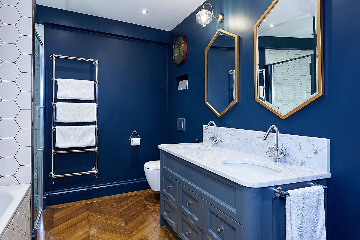 Frames of the hexagonal mirrors add metallic glitter to this gorgeous blue and white bathroom