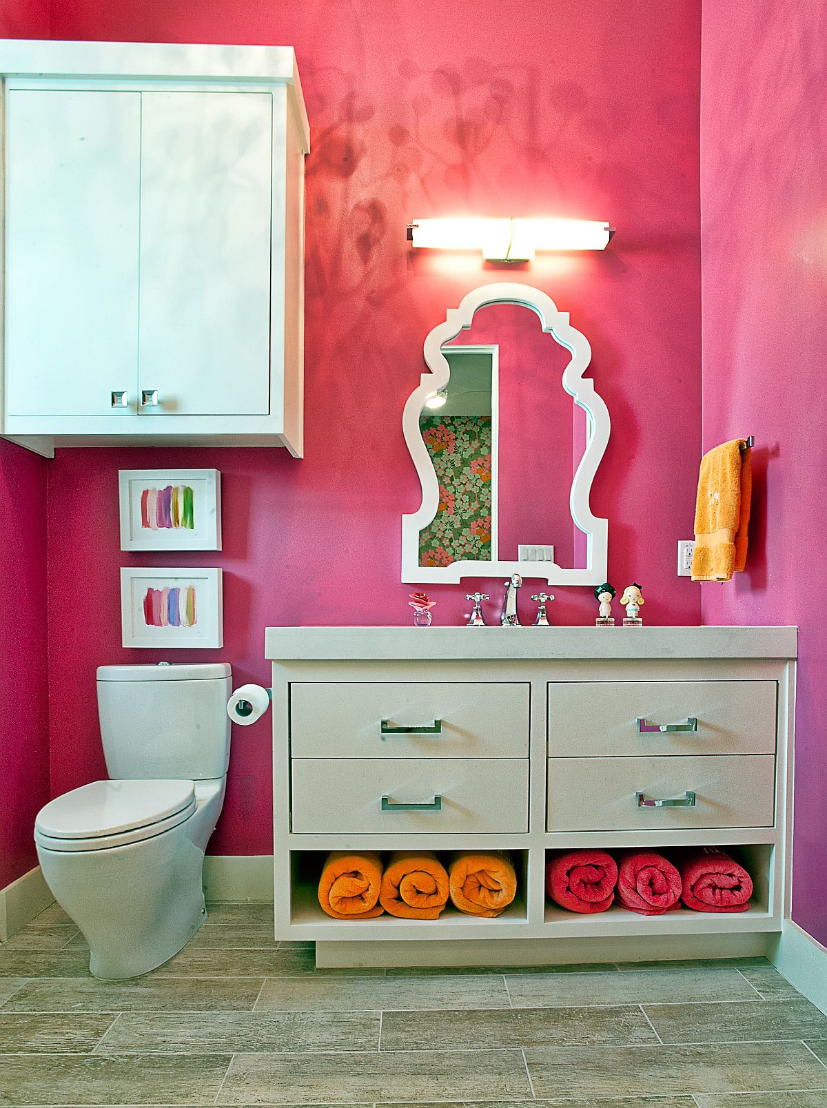 Fuchsia brings brightness and eclectic charm to this bathroom