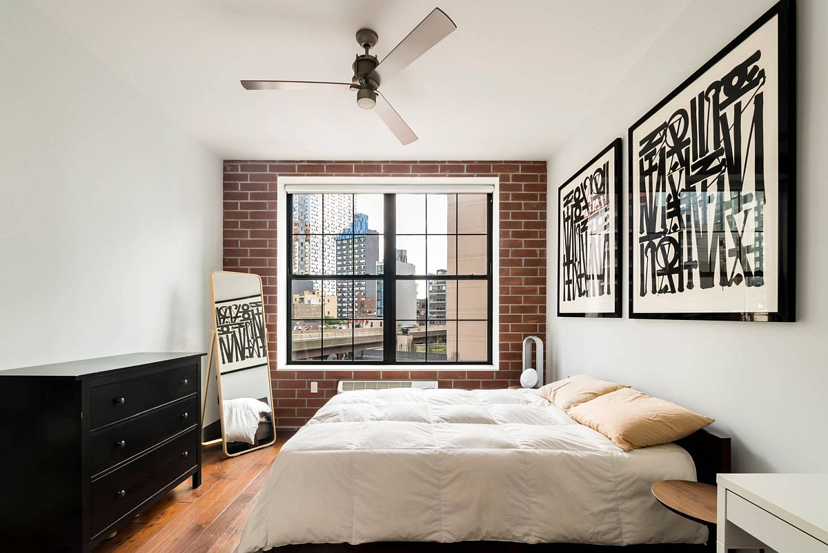 Glam-NYC-bedroom-in-white-with-chic-frame-art-workand-faux-brick-wall-55810