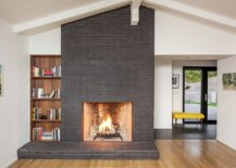 Gorgeous-fireplace-in-gray-along-with-wooden-bookshelf-in-the-spacious-white-living-room-80763-217x155