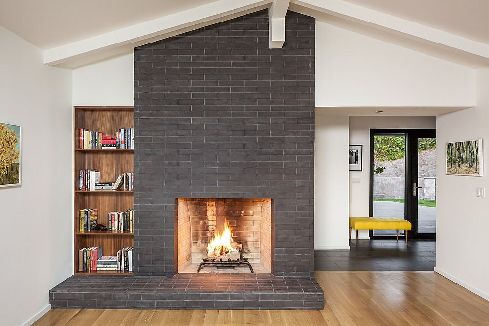 Gorgeous-fireplace-in-gray-along-with-wooden-bookshelf-in-the-spacious-white-living-room-80763