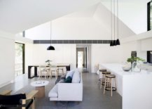 Gorgeous-living-area-of-the-home-with-white-monochromatic-interior-concrete-floor-and-black-accents-11740-217x155