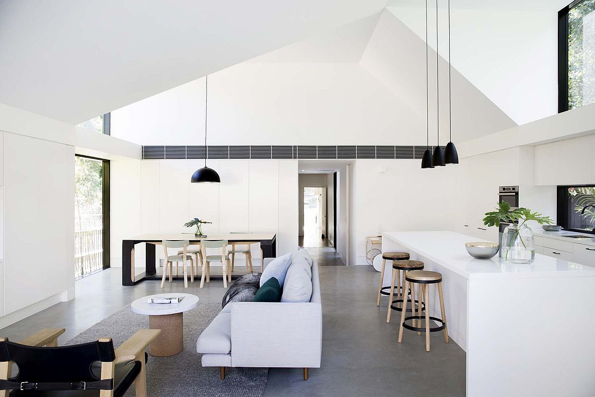 Gorgeous-living-area-of-the-home-with-white-monochromatic-interior-concrete-floor-and-black-accents-11740
