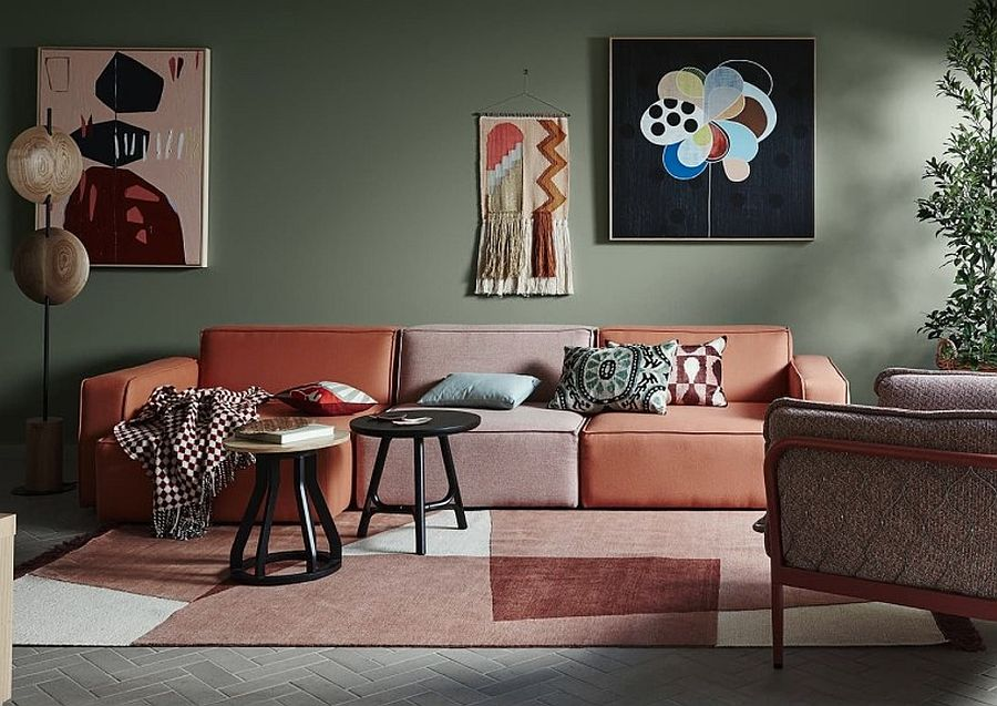 olive green walls paired with coral living room sofa
