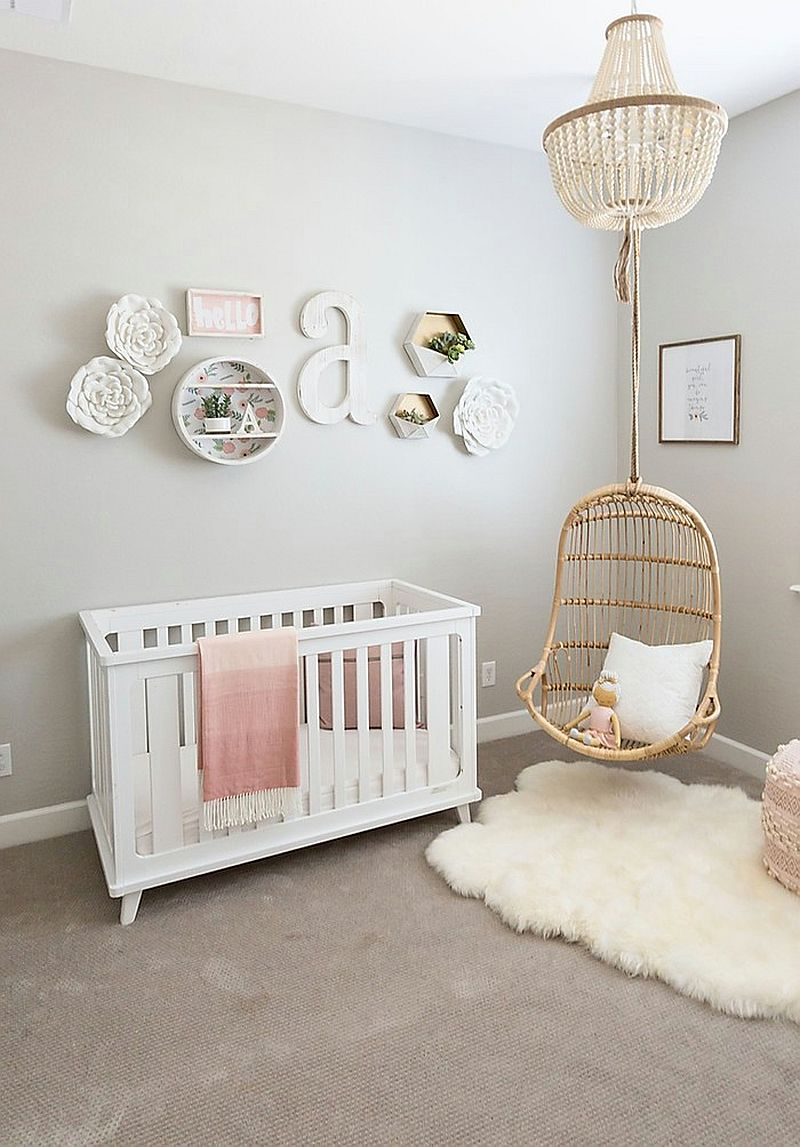 Gorgeous shabby chic nursery with comfy rug and minimal decor