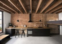 Gorgeous-single-wall-kitchen-with-brick-wall-backdrop-inside-the-small-attic-apartment-79204-217x155