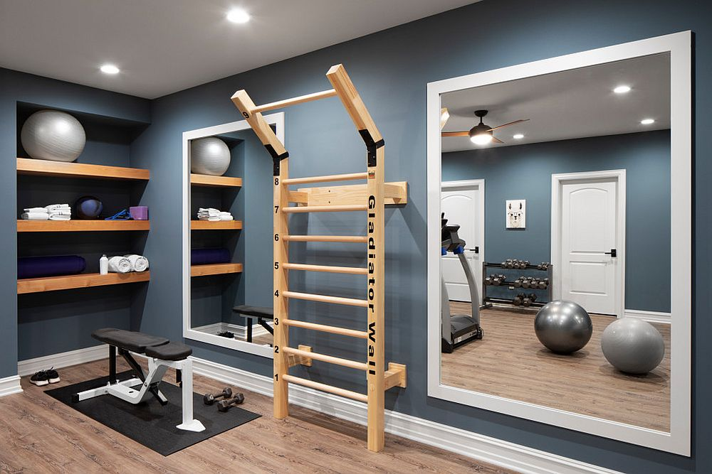 Gorgeous small home gym in gray with a mirror and shelf space