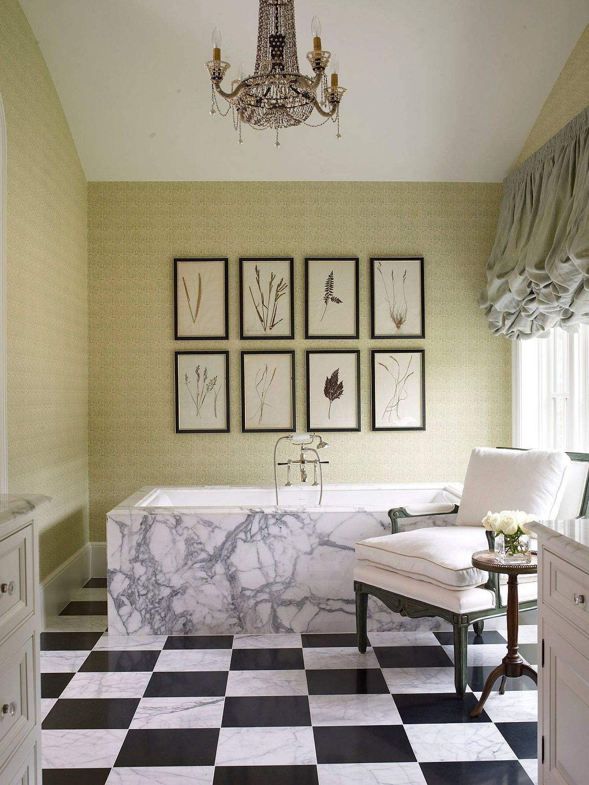 Green-and-white-bathroom-with-black-and-white-tiles-and-framed-botanical-prints-on-the-accent-wall-64799