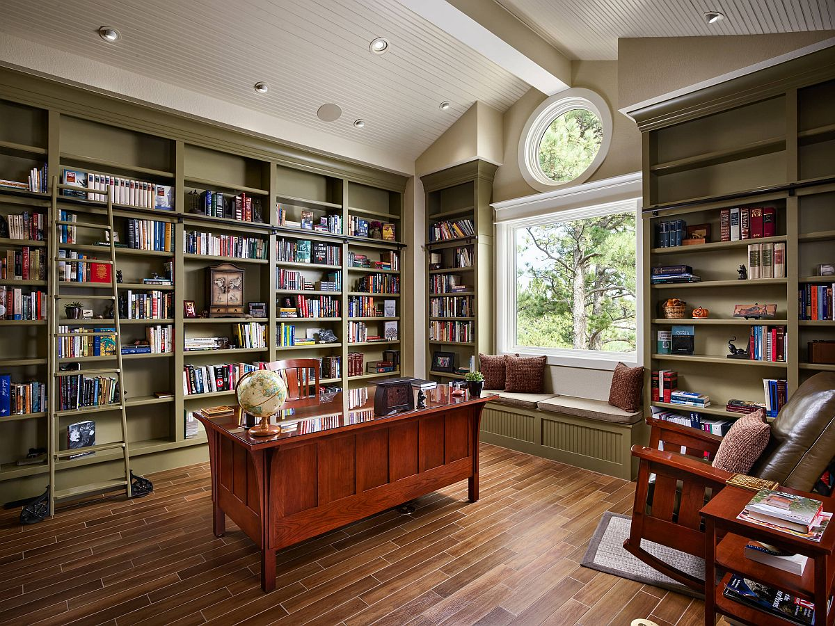 home office with floor to ceiling olive green book shelves
