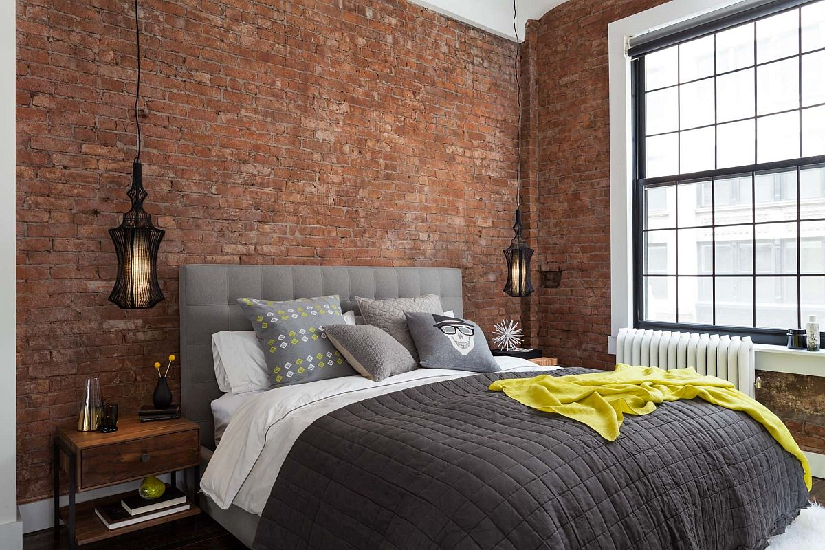 Industrial-modern-bedroom-with-exposed-brick-walls-and-a-large-window-inside-New-York-home-90540