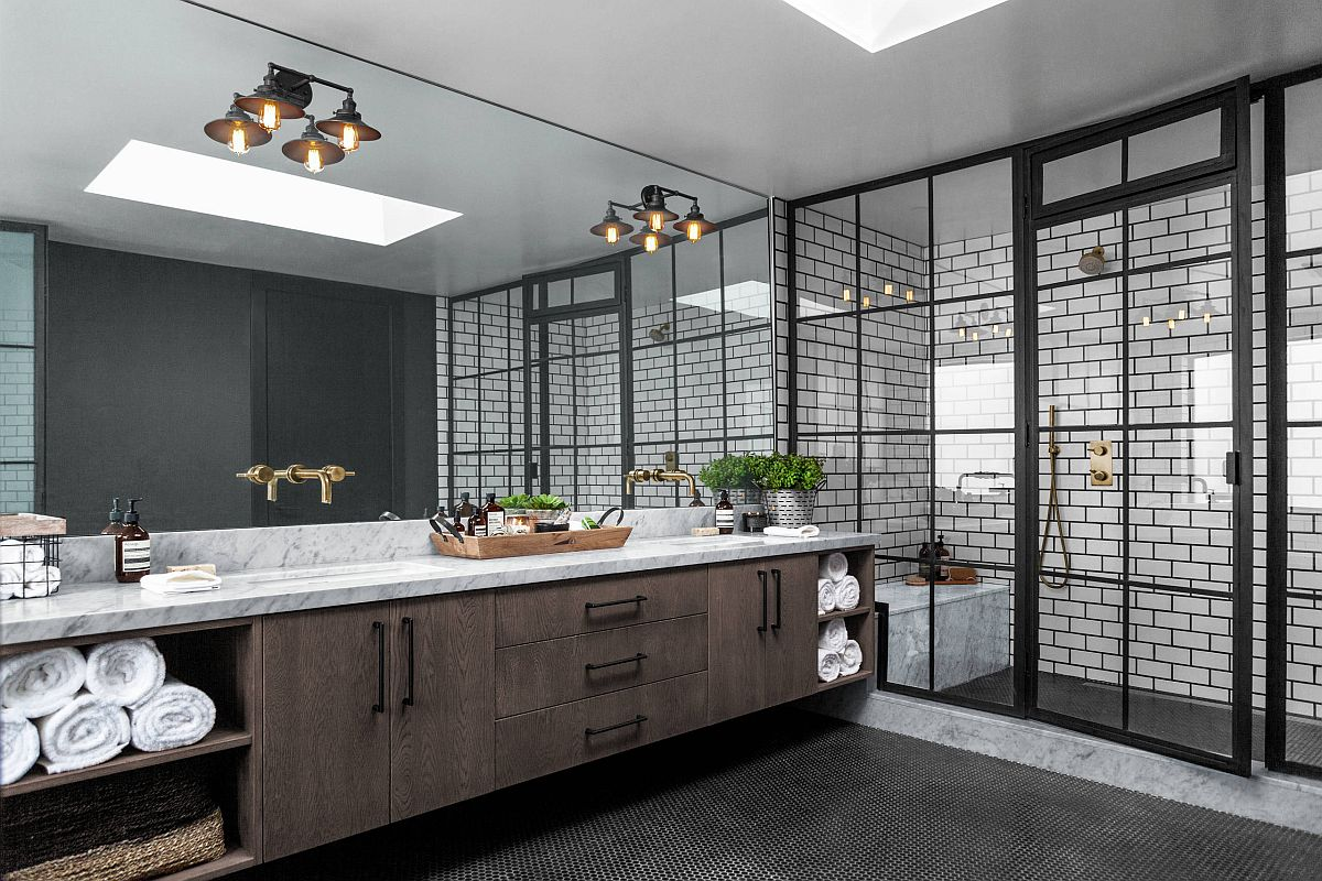 Industrial style bathroom in black and white with a large wooden vanity and floating shelves