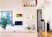 Interesting-pops-of-accent-colors-added-to-the-living-area-with-rugs-and-vases-29137-217x155