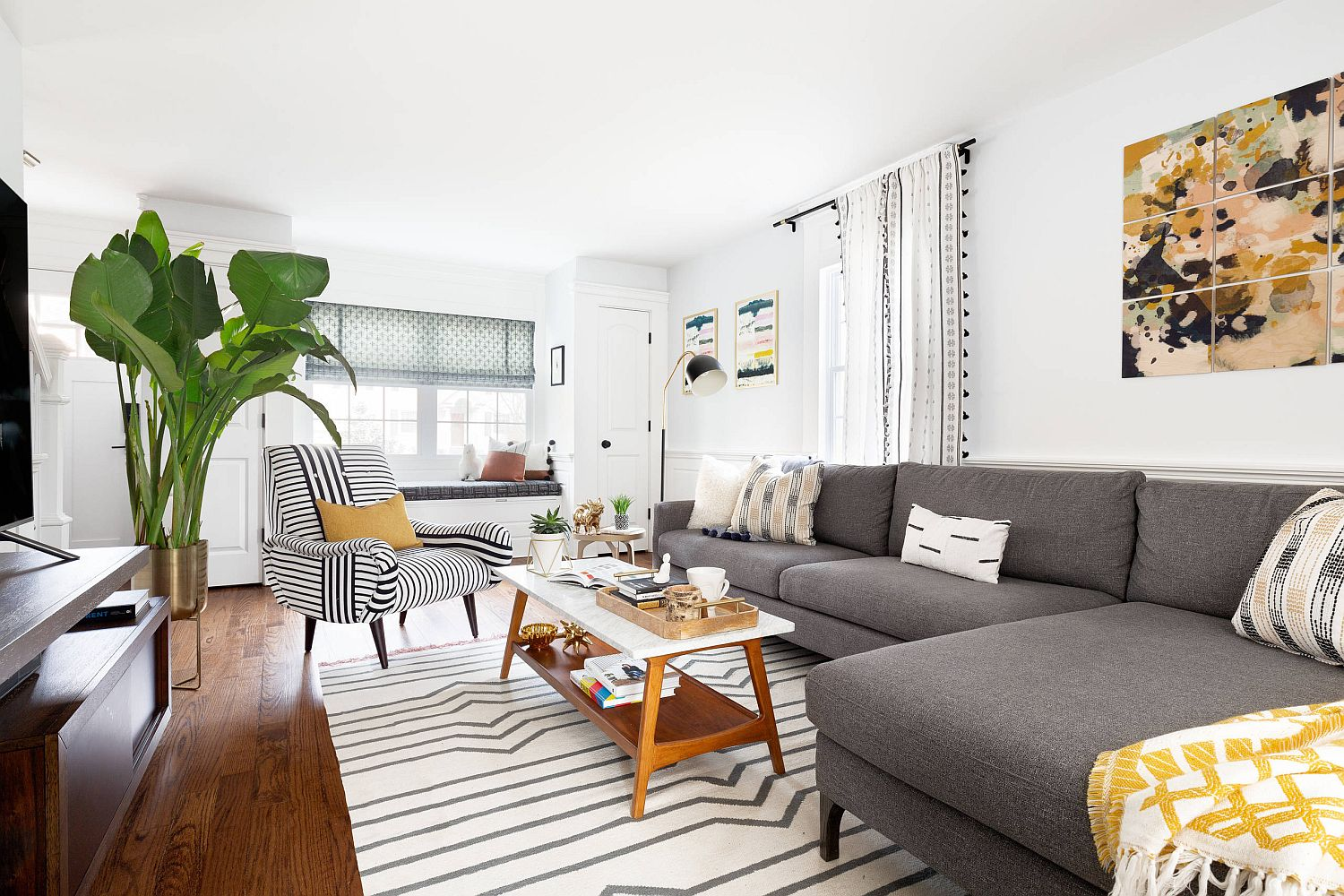Interesting-use-of-multiple-stripes-on-the-accent-chair-along-with-the-rug-give-this-contemporary-living-room-a-snazzy-appeal-13063