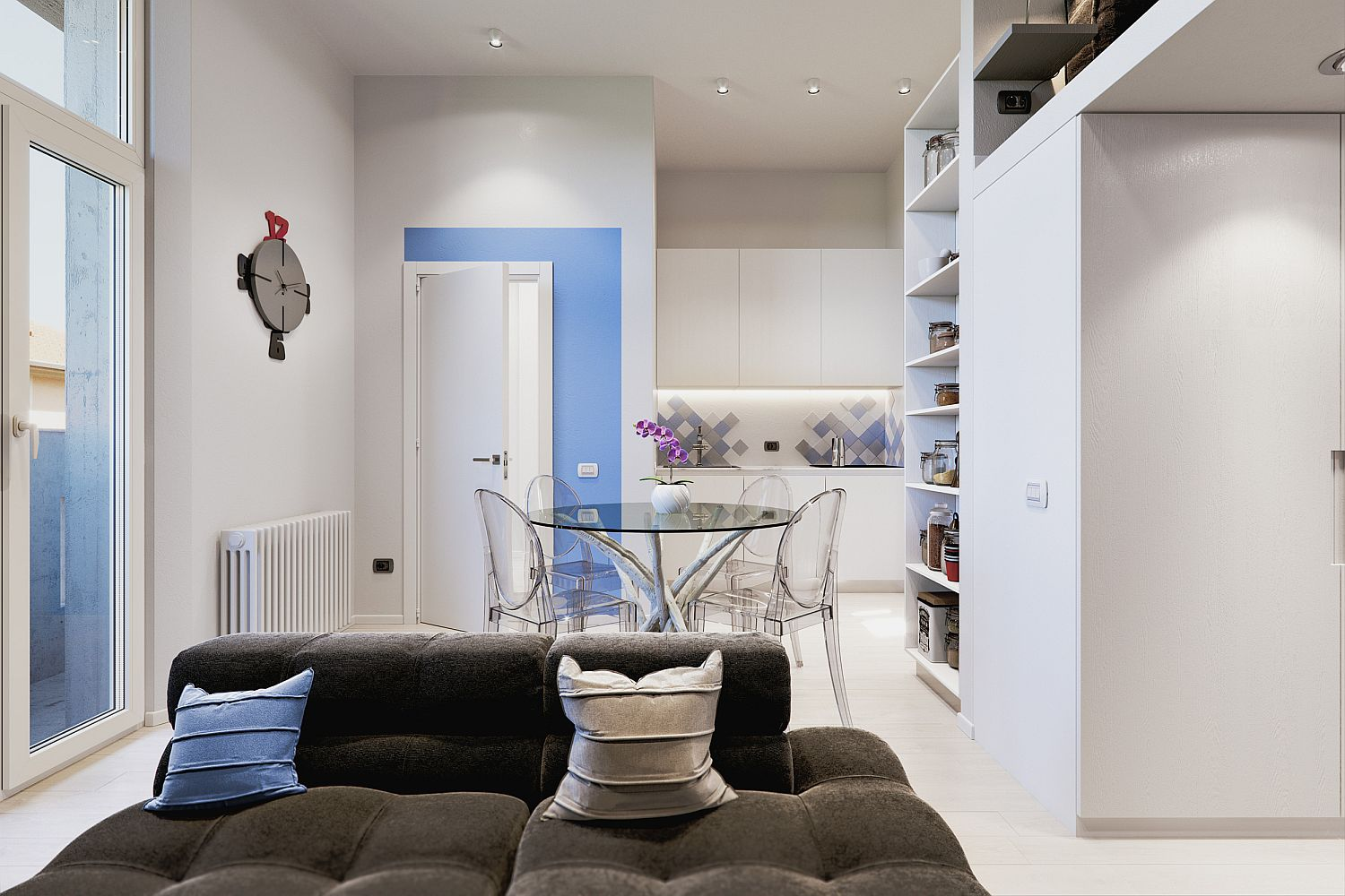 Just a dash of blue with accent wall feature and throw pillow adds color to the tiny interior