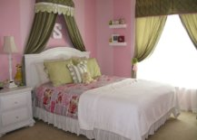 pink kids room with olive green bed canopy