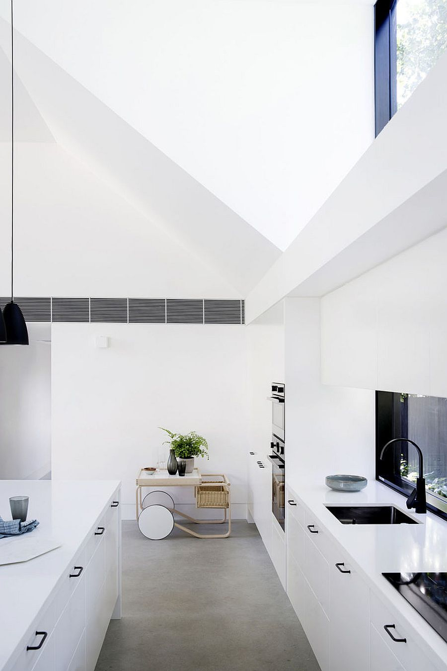 Kitchen-of-the-house-at-the-corner-feels-both-modern-and-has-a-space-savvy-design-11653