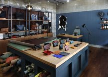 Leather-shop-with-open-shelves-coupled-with-wooden-cabinets-feels-spacious-despite-ample-storage-opportunities-42484-217x155