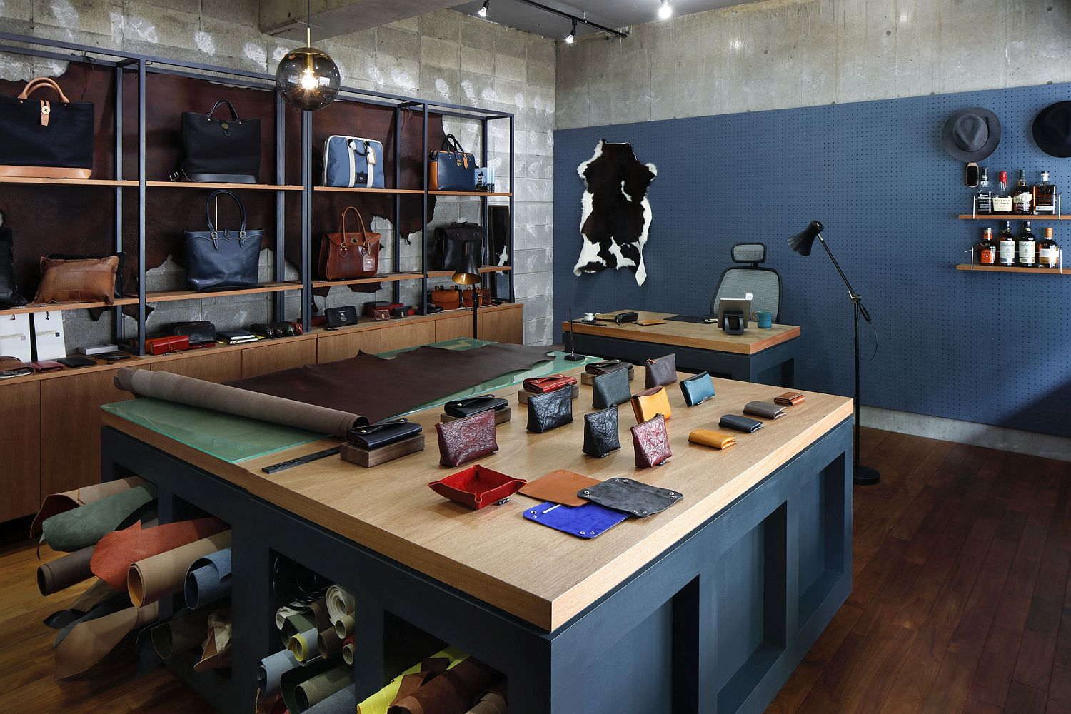 Leather shop with open shelves coupled with wooden cabinets feels spacious despite ample storage opportunities
