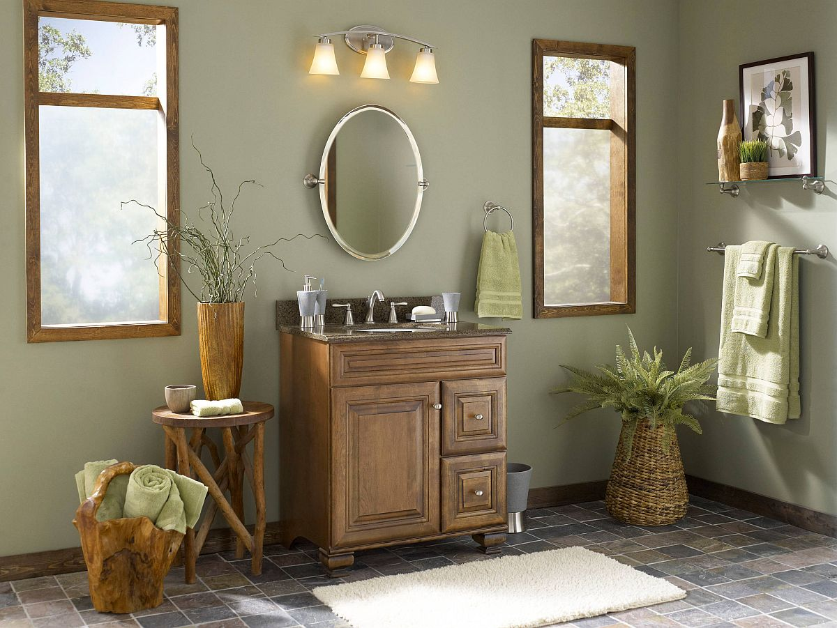 earth tones in bathroom with olive green walls