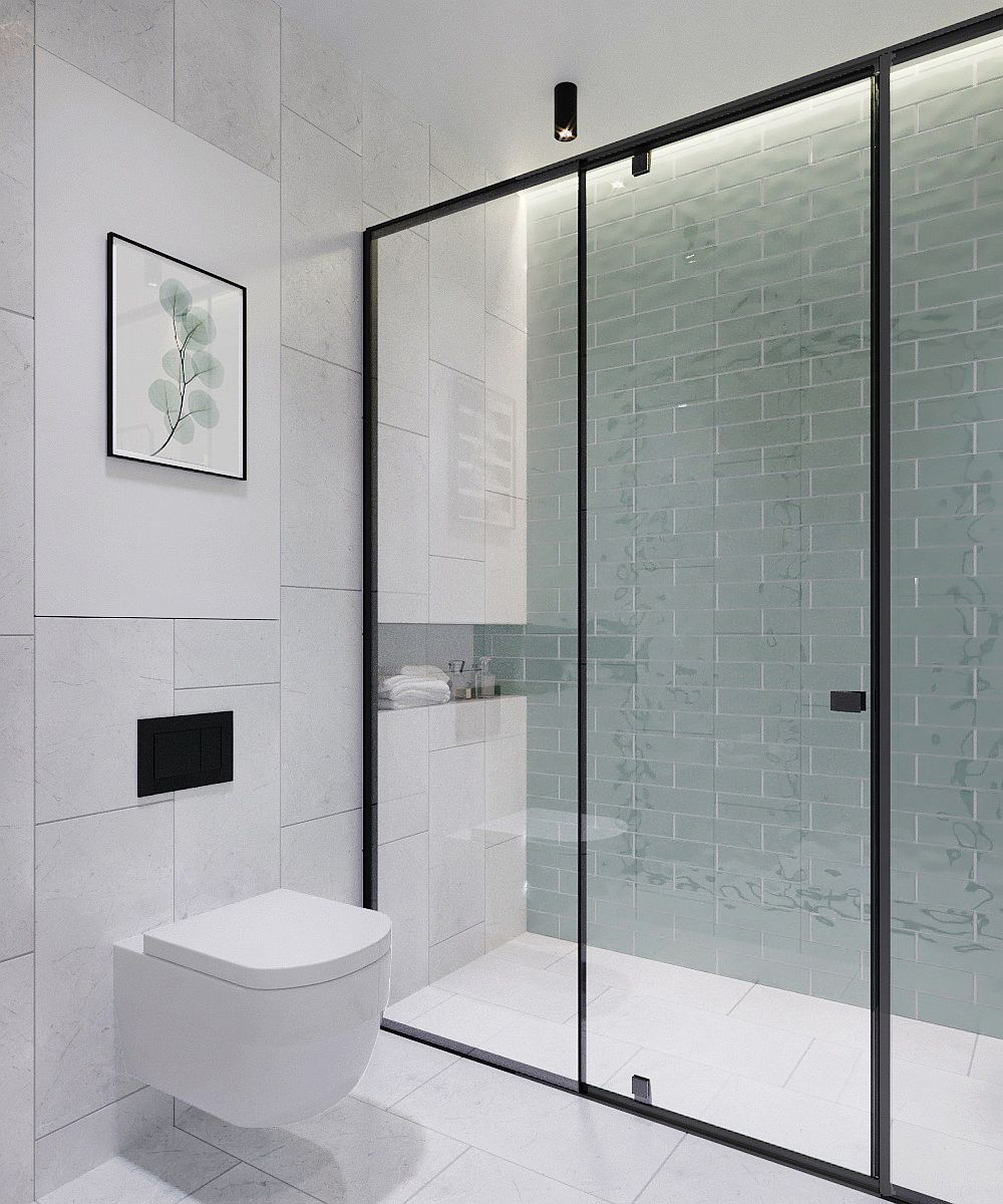 Light blue tiles in the shower area add just a hint of color