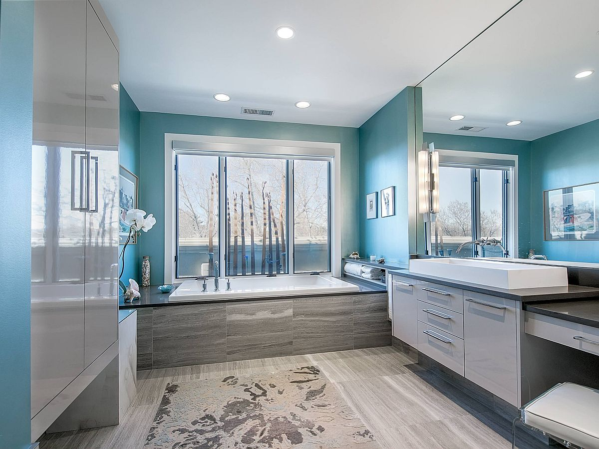 Light-filled and spacious modern bathroom in gray and blue